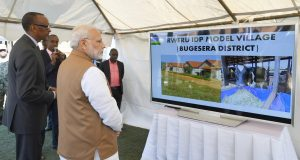 """The Prime Minister, Shri Narendra Modi participating in the """"Girinka"""" (one cow per poor family programme), during his visit to Rweru Model village, in Rwanda on July 24, 2018. The President of Rwanda, Mr. Paul Kagame is also seen."""
