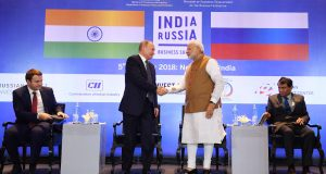 The Prime Minister, Shri Narendra Modi and the President of Russian Federation, Mr. Vladimir Putin at the India-Russia Business Summit, in New Delhi on October 05, 2018. The Union Minister for Commerce & Industry and Civil Aviation, Shri Suresh Prabhakar Prabhu is also seen.