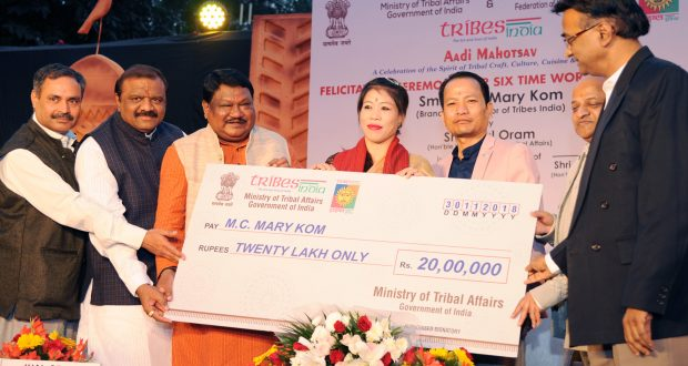 The Union Minister for Tribal Affairs, Shri Jual Oram felicitating the six time World Champion and Brand Ambassador of Tribes India, Smt. M.C. Mary Kom, at a function, at Dilli Haat, INA, in New Delhi on November 27, 2018. The Minister of State for Tribal Affairs, Shri Jaswantsinh Sumanbhai Bhabhor, the Secretary, Ministry of Tribal Affairs, Shri Deepak Khandekar and other dignitaries are also seen.