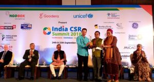 Union-Minister-Shri-Anant-Hegde-Presenting-CSR-IMpact-Award-to-JSPLs-Head-CSREdu-Shri.-Prashant-Kumar-Hota-1-696x392