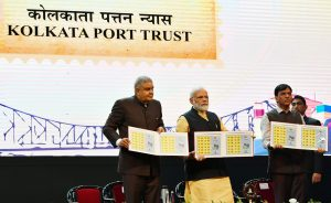 The Prime Minister, Shri Narendra Modi releasing the commemorative stamp marking celebrations of 150 years of Kolkata Port Trust, in Kolkata, West Bengal on January 12, 2020. The Governor of West Bengal, Shri Jagdeep Dhankhar and the Minister of State for Shipping (Independent Charge) and Chemicals & Fertilizers, Shri Mansukh L. Mandaviya are also seen.
