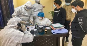 New Delhi: In this handout photo provided by Indo-Tibetan Border Police (ITBP), Indian nationals who were airlifted from coronavirus-hit Hubei province of China's Wuhan, undergo tests  inside a quarantine facility set by up ITBP, at Chhawla area of New Delhi, Monday, Feb. 3, 2020.  As many as 647 Indians have been evacuated through two special Air India flights amid reports of more than 300 people being killed due to the virus in China. (PTI Photo)(PTI2_3_2020_000109B)