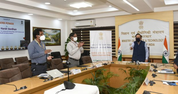 """The Union Minister for Health & Family Welfare, Science & Technology and Earth Sciences, Dr. Harsh Vardhan launches a women-specific scheme titled """"SERB-POWER (Promoting Opportunities for Women in Exploratory Research)"""", through video-conferencing, in New Delhi on October 29, 2020. The Secretary, Department of Science and Technology, Prof. Ashutosh Sharma and other dignitaries are also seen."""