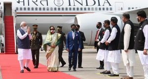 The Prime Minister, Shri Narendra Modi being received by the Prime Minister of Bangladesh, Ms. Sheikh Hasina, on his arrival at Hazrat Shahjalal International Airport, in Dhaka, Bangladesh on March 26, 2021.